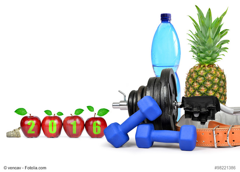 Fruit, dumbbells and PET bottle with drinking water. Healthy resolutions for the New Year 2016