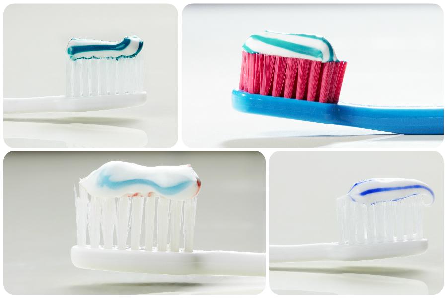 Zahnpasta auf zahnbürsten