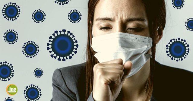 Frau mit Atemmaske hustet. Informationen zu dem Coronavirus und dem Besuch in der Zahnarztpraxis.